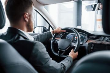 modern-businessman-trying-his-new-car-automobile-salon