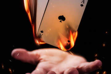 magician-s-hand-performing-trick-with-playing-card